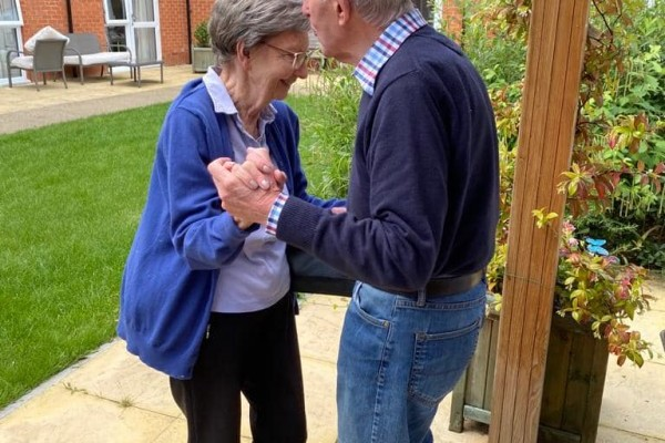 New residents with carer at care home